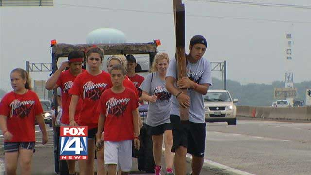 God's Worst Marketing Scheme: Junior Garcia walks to DC with Cross On Back